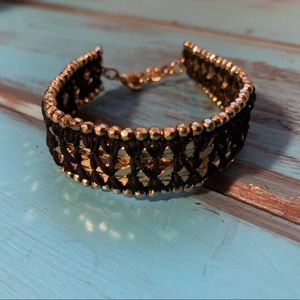 Gold and black cuff bracelet